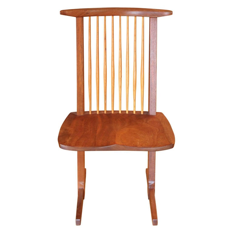 Beautiful set of ten George Nakashima Conoid dining Chairs in black walnut and hickory. These came from a private estate in Houston, TX where they collected original Nakashima pieces. Seat pads are available and we have the complete documentation