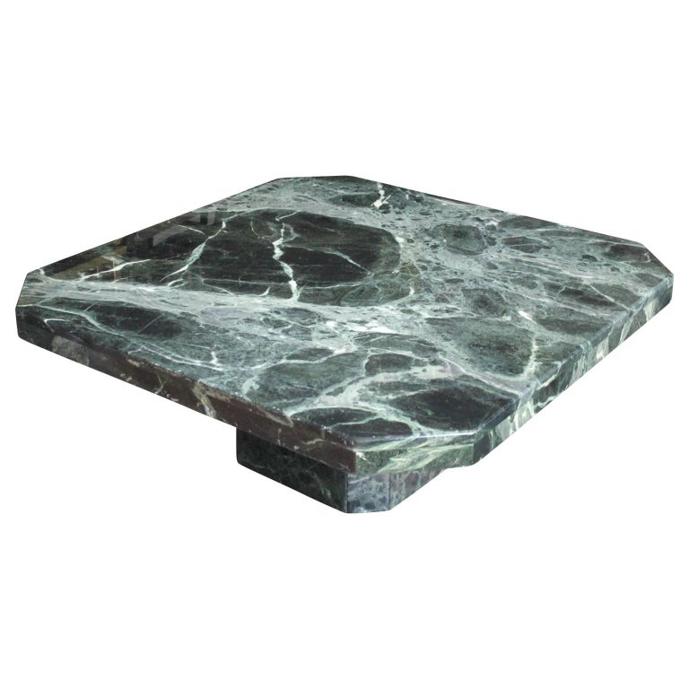 Stunning Italian pedestal coffee table made from the most gorgeous green marble. This piece is in two parts. The heavy marble top detaches from the pedestal base, making it easy to transport. Perfect addition to any modern or mid-mod space. Has a