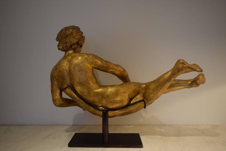 """This giltwood sculpture was carved in the round, probably in southern France or northern Italy in the 1760s.  Her pronounced musculature speaks to the ongoing influence of Michelangelo.  On the modern bronze stand the sculpture is 18"""" high,"""