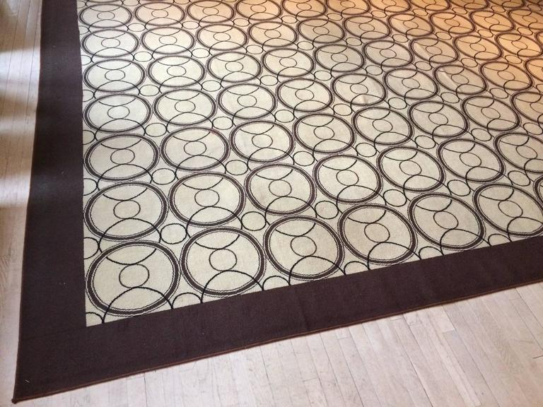 This large 1960s rug was designed by Baron Alessandro Albrizzi and installed in his London shop, as seen in the vintage photograph accompanying this listing.  He then had it shipped to New York where he placed it in his living room. The brown,