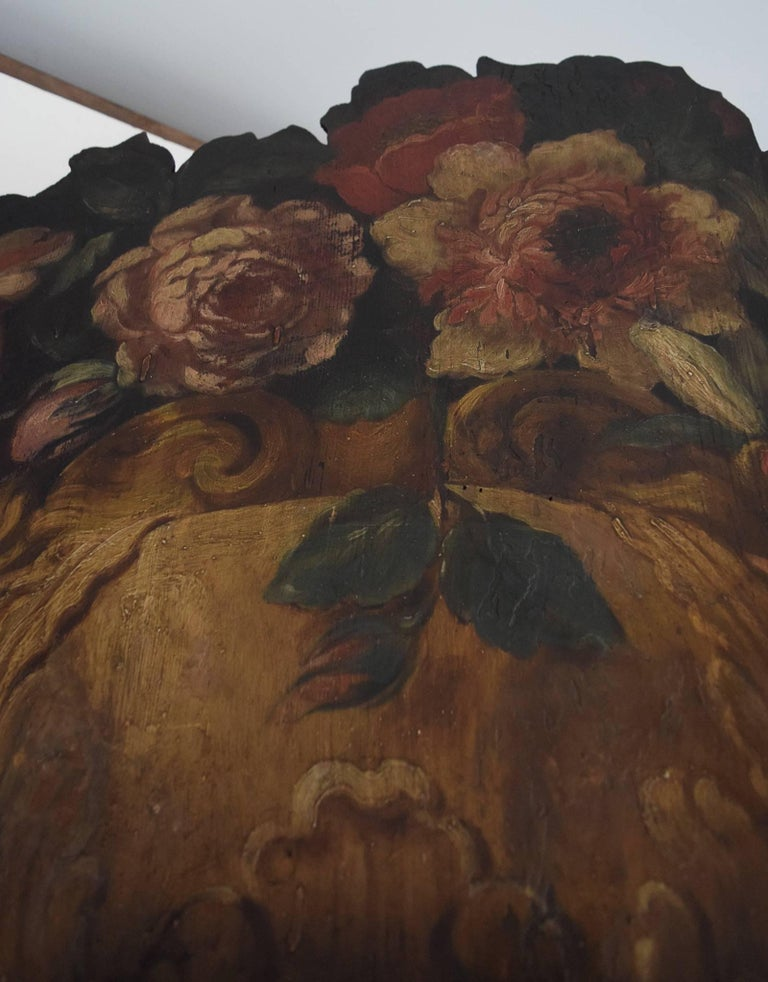 This dummy board, a trompe l'oeil depiction of a marble vase overflowing with blowsy flowers, is probably Italian, and dates to the late 18th century.