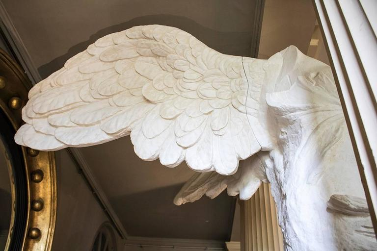 Plaster cast of The Winged Victory of Samothrace (also know as The Winged Nike) after Parisian marble original on display at the Louvre, Paris,  Early 20th century, Private Paris Studio.  Although the original creator of Nike is unknown, H. W.