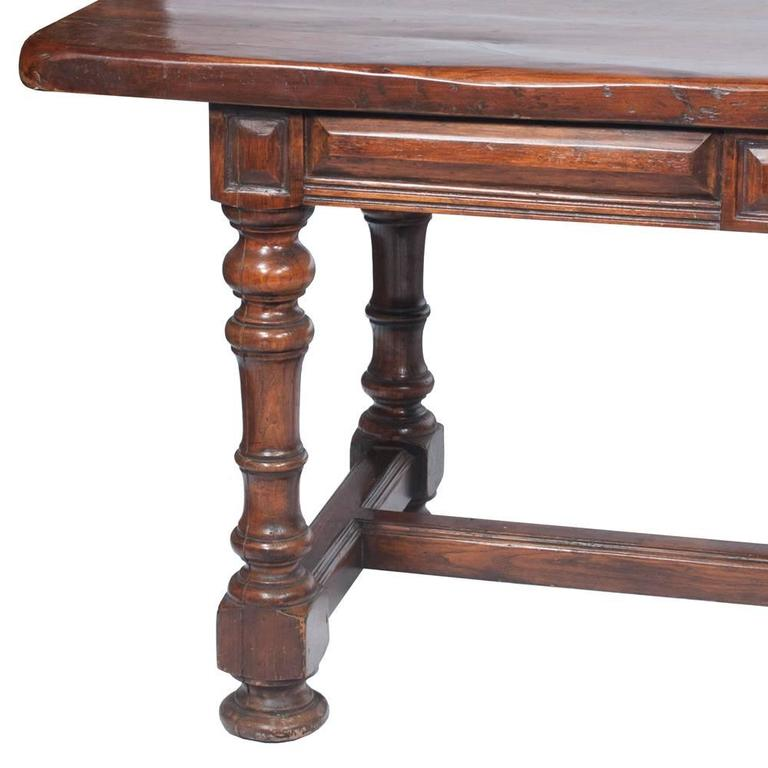 This English Country farmhouse table features a drawer at one end for storage...middle trestle for added support and side to leg supports as well. The apron clearance is 25.5