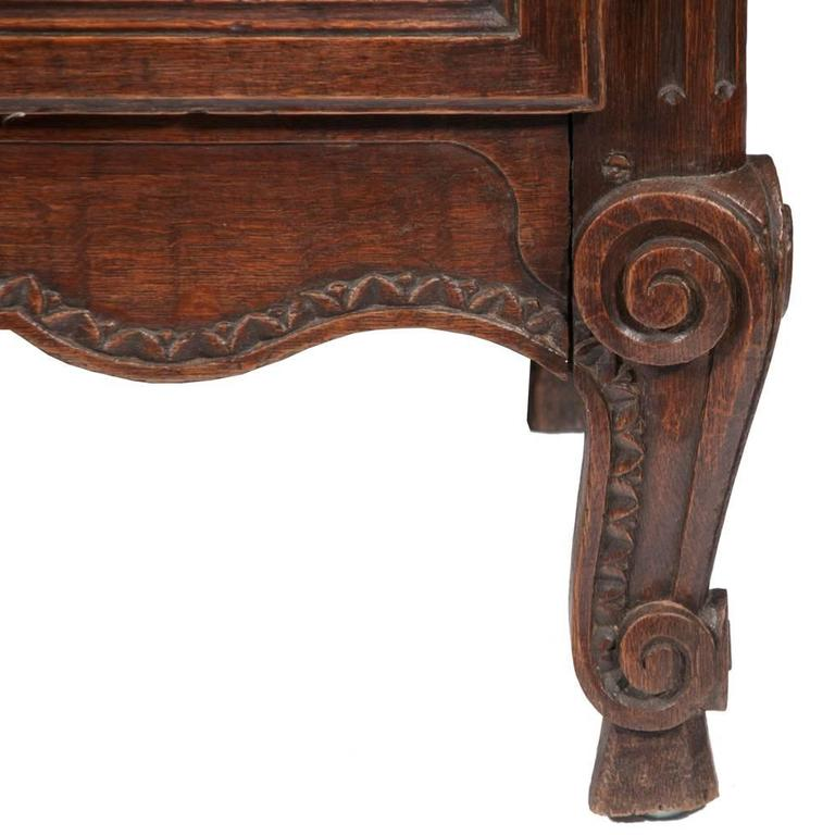 Classic Country French two-part buffet de corps with an arched and carved pediment, featuring grill work doors. The base has two arched panel doors and a shaped apron, circa 1860.