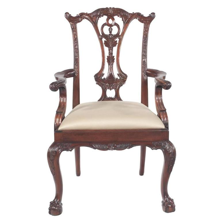 Set of ten solid mahogany dining chairs by Maitland-Smith. Chairs have pierced, carved backs, carved cabriole legs and ball and claw feet. Seats are cream upholstered in a sateen fabric, neutral.  Dimensions: Armchairs are 27