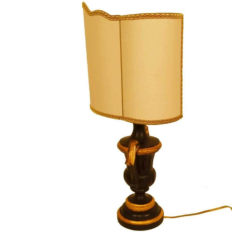 Pair of gold gilded black French lamps with the Classic French shield shades, trimmed in gold.