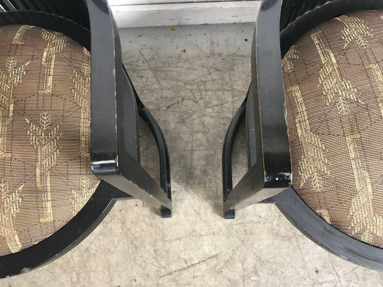 Pair of 606 Barrel Taliesin chairs Frank Lloyd Wright for Cassina... Retains original dark Lacquer finish as well as arts and crafts style upholstered seats. Cassina impressed mark.