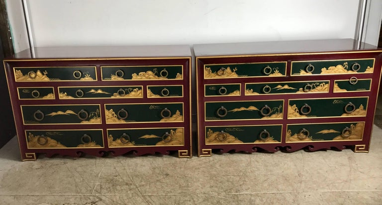 Pair of highly decorated lacquered nine-drawer chests or dressers, Stunning Japanese themed motif featuring burgundy and hunter green lacquer with gold relief detailing, solid brass graduated hand pulls, amazing quality and construction, attributed