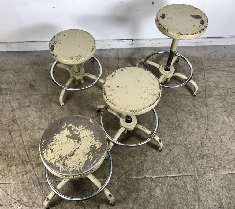 Set of Four Industrial Adjustable Multi Position Metal Stools by Ajusto In Distressed Condition For Sale In Buffalo, NY