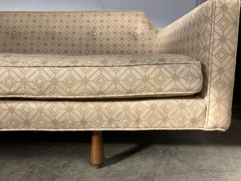 Modernist sofa designed by Edward Wormley for Dunbar, Wonderful example, down cushions, Retains fabulous original fabric in nice condition. Sensuous graceful lines, Hand delivery avail to New York City or anywhere en route from Buffalo New York.