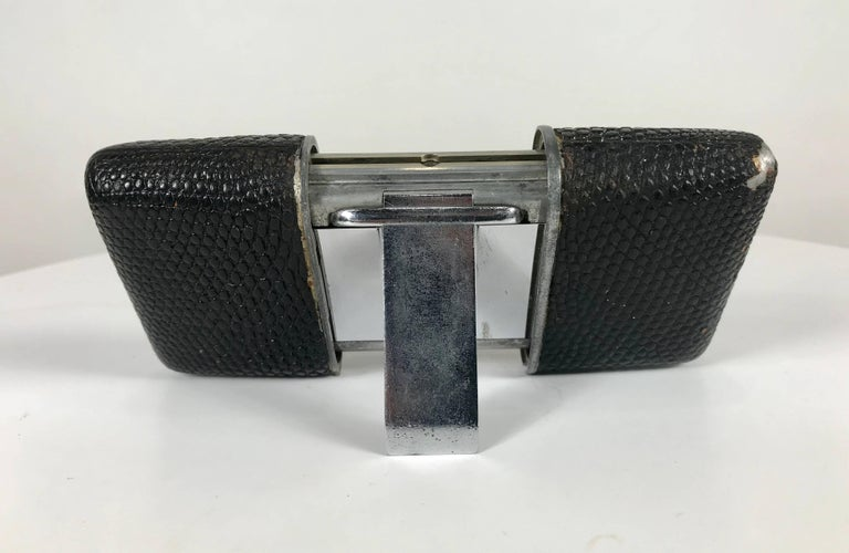 Early Movado Ermeto for Hermes leather and steel travel clock, rarer version featuring black face with luminous hands and time markers, works perfectly, worn leather to corner.