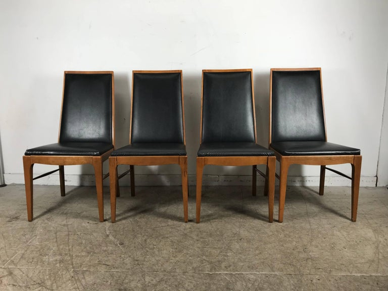 Set of four modernist walnut dining chairs by Lane Classic, simple elegant styling, solid walnut frames, Sturdy, tight joints, extremely comfortable. Hand delivery avail to New York City or anywhere en route from Buffalo New York.