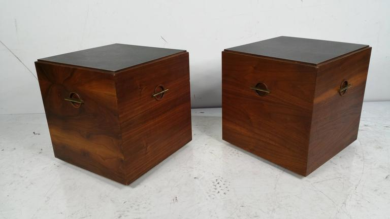 Unusual pair of stands manufactured by Lane,, Figured walnut wood,,handsome brass detailing to all four sides,, Faux slate tops,,on castors.