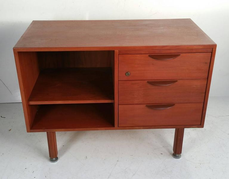 Jens Risom Walnut Credenza featuring 3 drawer (R) and adjustable shelf,(L),Sleek simple design,Great size..proportion.Retain original stainless steel foot glides.;levelers.Lacquered metal hand pulls.Jens Risom Design Label.