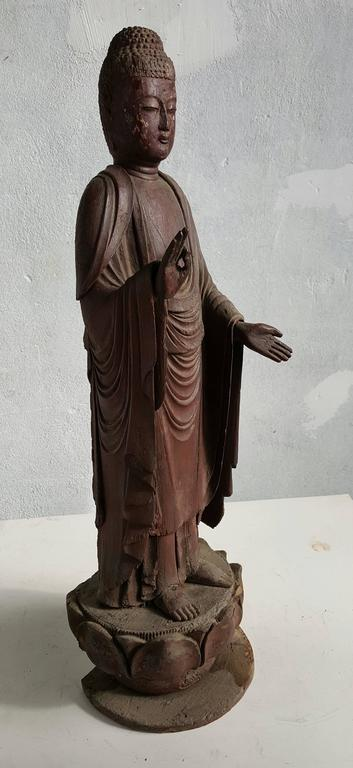 A Japanese carved wood Buddha figure Amida Nyorai (Buddha Amitabha),Mid 19th century, Cypress wood with traces of pigment and lacquer gold leaf. Standing on a lotus Zishi . This masterpiece is exquisitely caved. From the draping of the robes and the