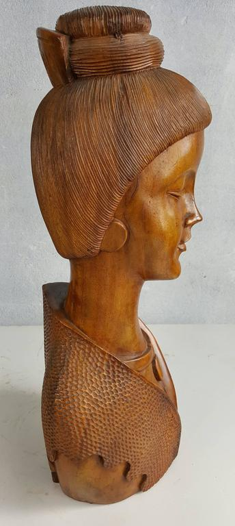 Solid mahogany carved wood womans bust, wonderful detailing, patina and coloring. Life-like face, hair, clothing and jewelry.