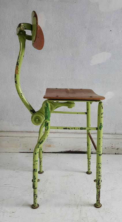 "Unusual medical or drafting Industrial stool, amazing design, double large bolt adjusters to make various position possibilities, as well as height adjustment, 18"" -22"", wonderful patina, layers of paint."