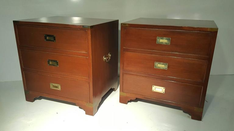 Classic pair of mahogany and brass Campaign stands/chest. Brass-mounted Campaign chest featuring three drawers with flush brass handles and larger handles on each side. This small chest of drawers or commode would make a great nightstand or bedside