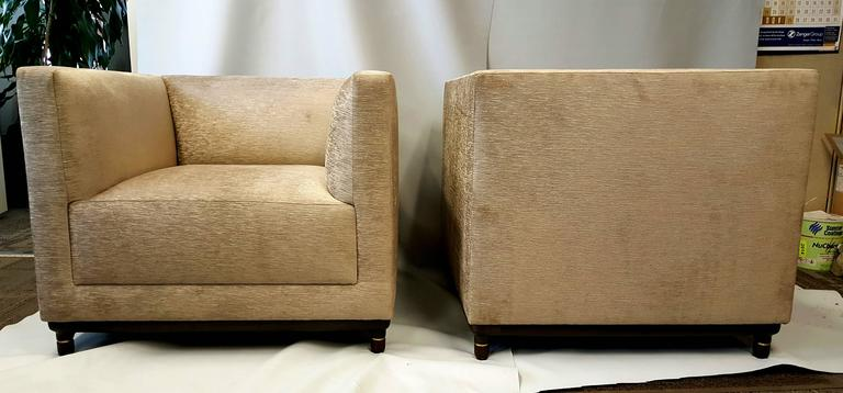 "Stunning pair of oversized lounge chairs. Classic Art Deco ""CUBE"" design. Superior quality and construction. Unusual walnut base with brass detailing. Extremely comfortable. Showroom condition."