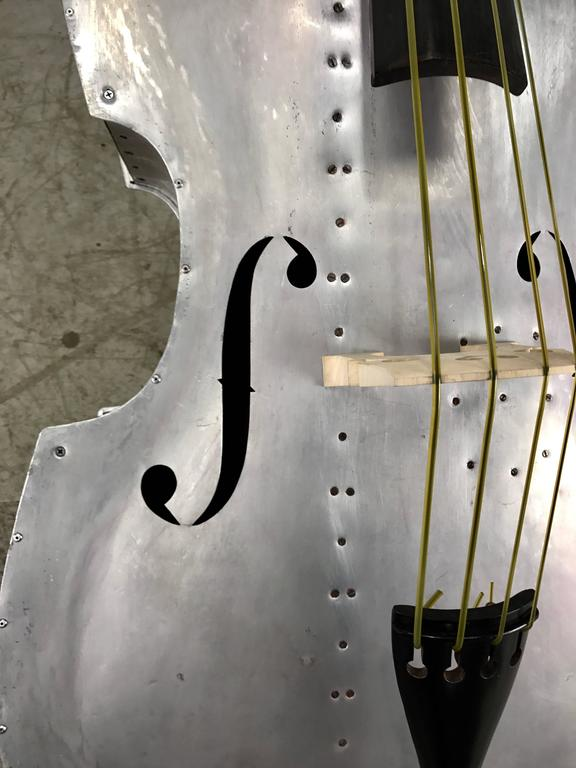 Extremely rare aluminum string bass, circa 1930s, bass was originaly wood grain painted, has been stripped, restrung and set up, new bridge and tail piece, original wood carved headstock missing scroll original ebony fret board, Sounds amazing. If