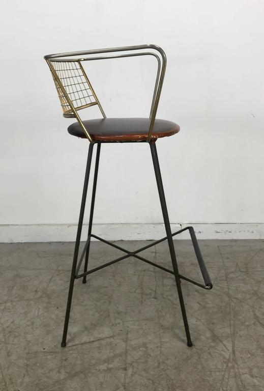Amazing Mid-Century Modern bar or counter stool, right out of the Jetsons, Classic sculptural brass Bertoia like design seats. As well as geometriciron base design with elements of Frederick Weinberg, Tony Paul, etc. Stunning, fun.