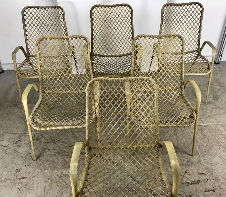 Set of six resin string chairs, modernist indoor / outdoor by Troy Sunshade, classic modernist design. Extremely comfortable. Hand delivery available to New York City or anywhere enroute from Buffalo New York.