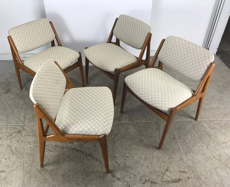 A set of four Danish Mid-Century Modern teak dining chairs by Arne Vodder for Vamo Sonderborg, solid sculptural teak frames with swivel backs for extra comfort, Hand delivery avail to New York City or anywhere enroute from Buffalo New York.