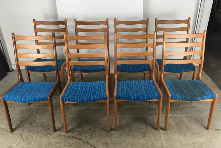 Set of eight Poul Volther teak side chairs by Frem Rojle, Classic Mid-Century design, superior quality and construction, finger joinery. Retains original Alexander Girard electric blue wool fabric, stunning, hand delivery available to New York City