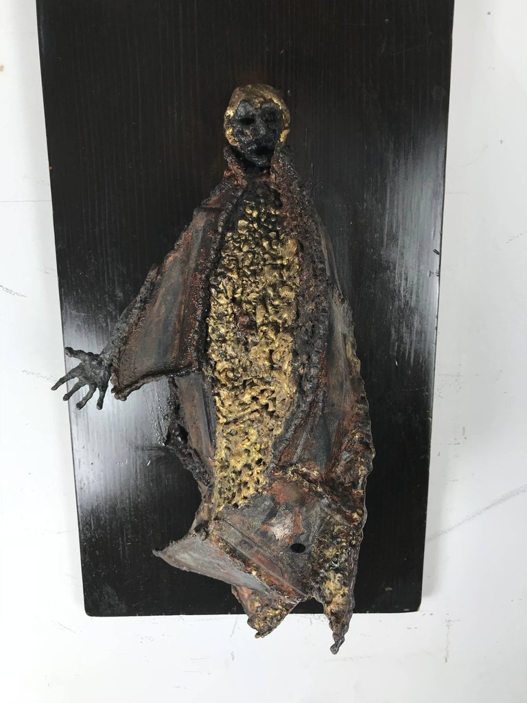 Unusual Brutalist bronze figure mounted sculpture, emotionally charged, raw imagery, beautifully hand executed, depicting cloaked person amazing texture and color, surface man measures 17 inches high x 8 inches wide x 6 inches deep.