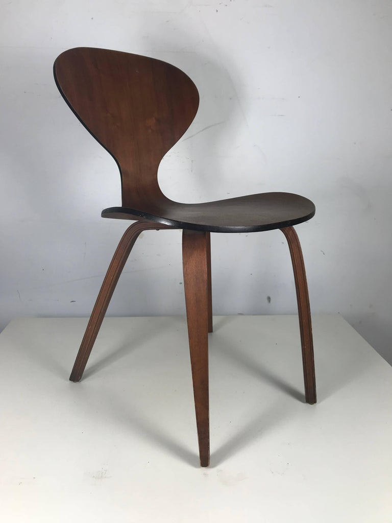 Classic Mid-Century Modern plywood chair by Norman Cherner for Plycraft. Wonderful warm walnut finish, nice original condition and patina, extremely comfortable, perfect occasional, accent or desk chair.