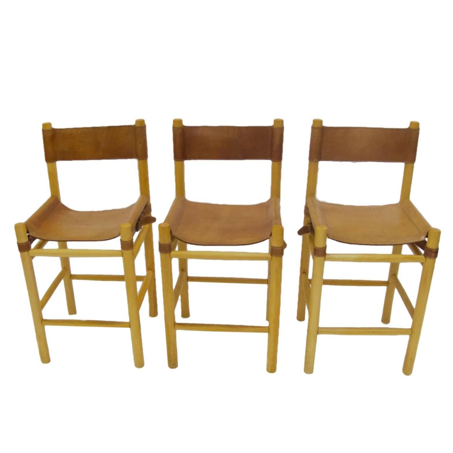 Leather With Buckles Safari Style Bar Stools In The Manner