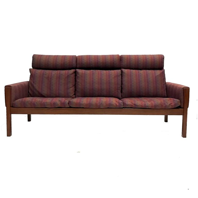 A very rare high back version of A.P. Stolen '62 Sofa' in teak. Price is low enough for reupholstery.