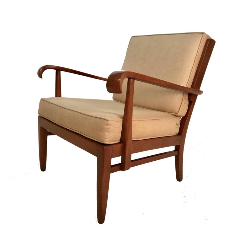 A sleek sophisticated pair of caned back armchairs designed by Walter and Willhelm Knoll from the 1930s.