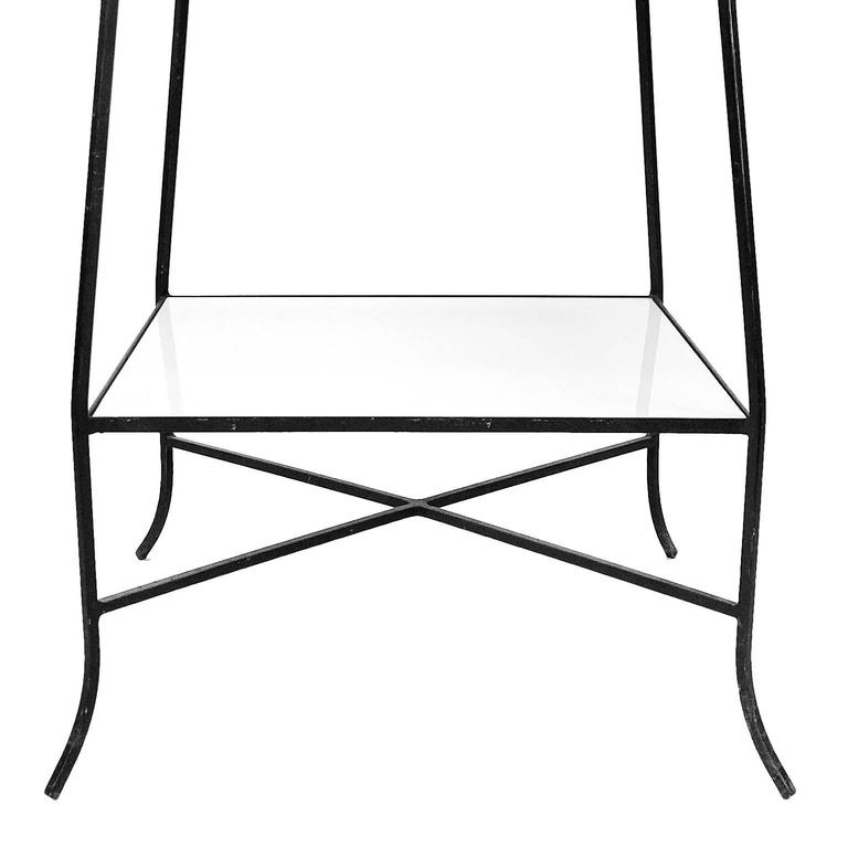 A highly decorative etagere. Reminiscent of Tommi Parzinger's designs. Five graduated milk glass shelves.