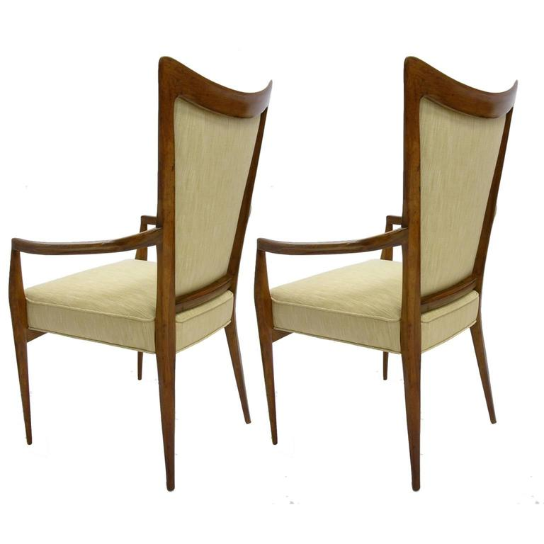 These chairs have just been upholstered with a beautiful, sturdy textured silk upholstery with gorgeous double piping detail. Gorgeous, sleek design.