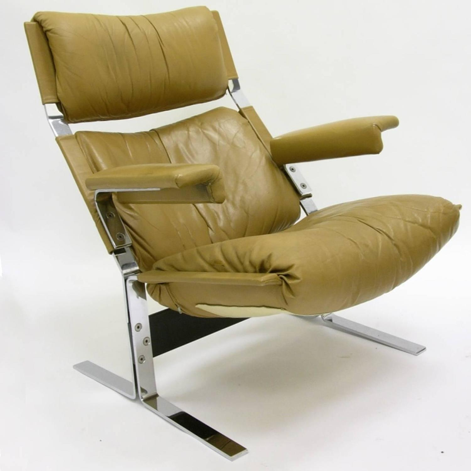 Comfortable steel and leather lounge chair and ottoman by for Comfortable chairs for sale