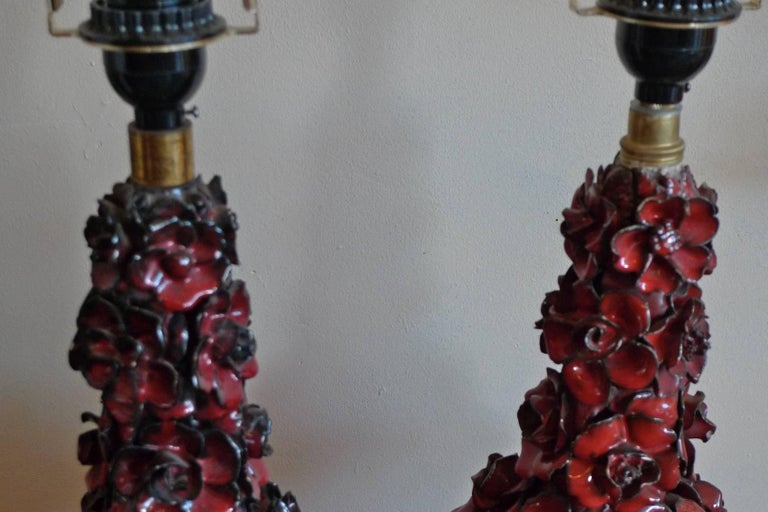 Two Spanish 1960s red glazed mansies (Valencia) ceramic table lamp.