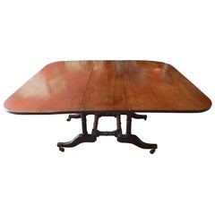 English Stained Elm and Mahogany Drop-Leaf Table on Four Iron Castors