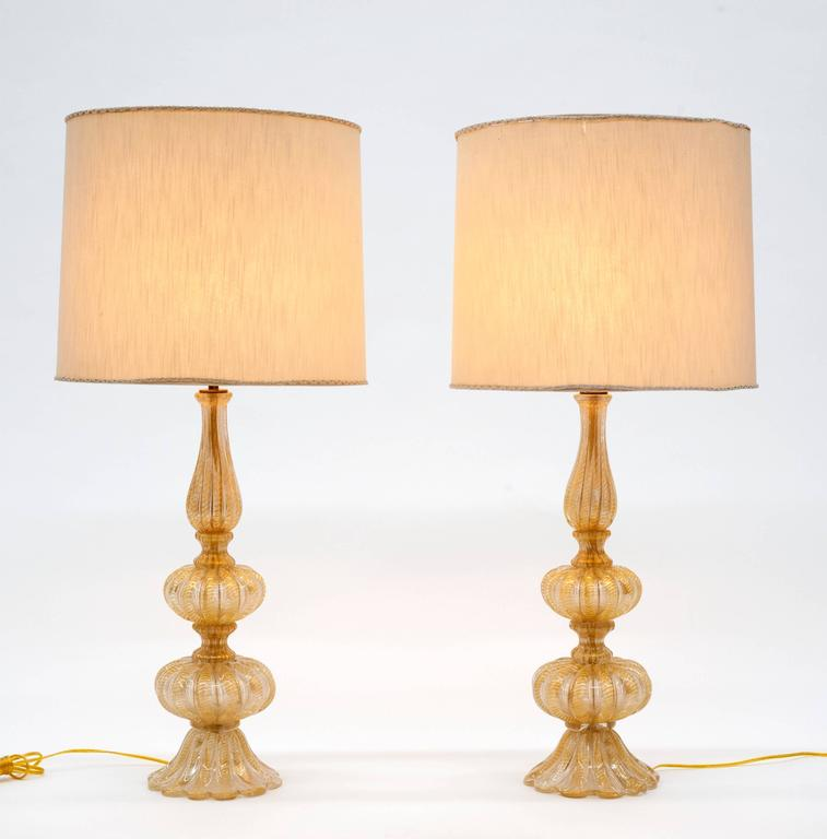 Fantastic pair of vintage glass lamps by Barovier & Toso. Lamps are heavy and exceptionally made. Rewired and ready to be enjoyed. One lamp has small bottom detail missing (please see last photo).