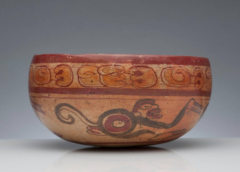 A fine Pre-Columbian Maya bowl, circa 600-900 A.D. Decorated with nicely detailed monkey's and painted glyphs. Measures 7.5 inches in diameter and 3.75 inches high.