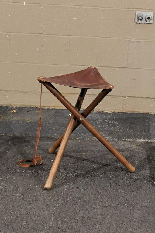 Three French Folding Wooden Stools With Brown Leather