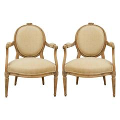 Pair of French, Louis XVI Style Carved Limed Oak Mid-19th Century Armchairs