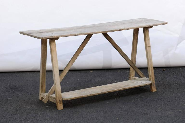 French Rustic Distressed Pine Console Table With Trestle Base And Bottom Shelf In Good Condition For