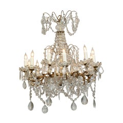 French 1920s Brass and Crystal Twelve-Light Chandelier with Scrolled Arms