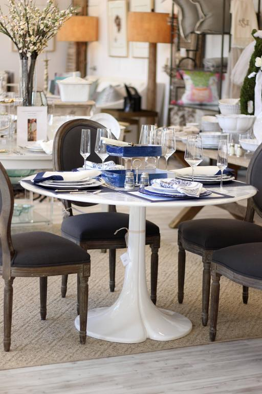french tulip style dining table with round top and