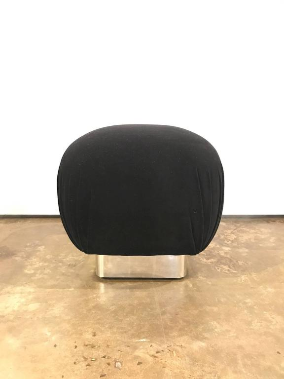 Offered is a mid century modern, newly upholstered in black velvet and chrome Karl Springer style pouf. This very glamorous piece will look fabulous in almost any room with any style of furniture.