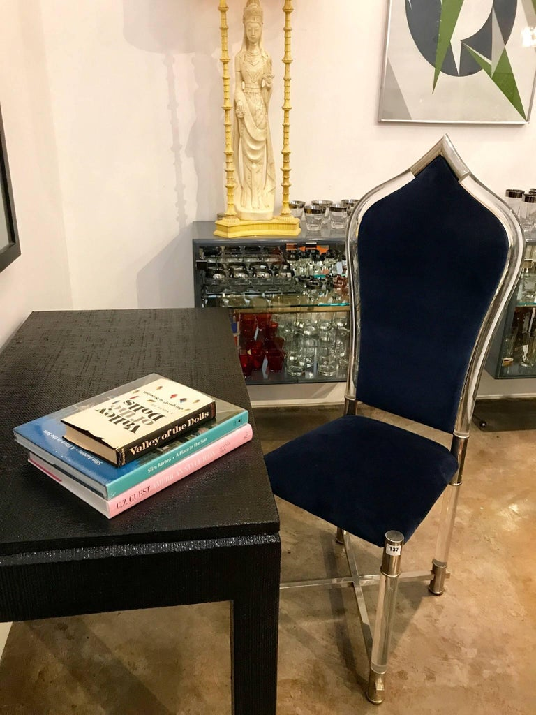 Offered is a Mid-Century Modern Italian and very special piece from Antonio Pavia. The accent chair of Lucite, chrome and new sapphire blue velvet is a nod to Moorish architecture. This chair would be perfect for writing table or desk, a vanity