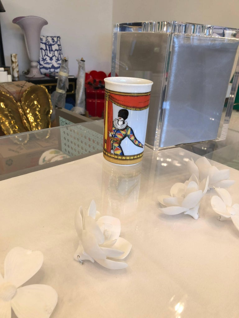 Offered is a brightly colored court jester themed petite vase by Fornasetti for Rosenthal with it's original decorative gift box.