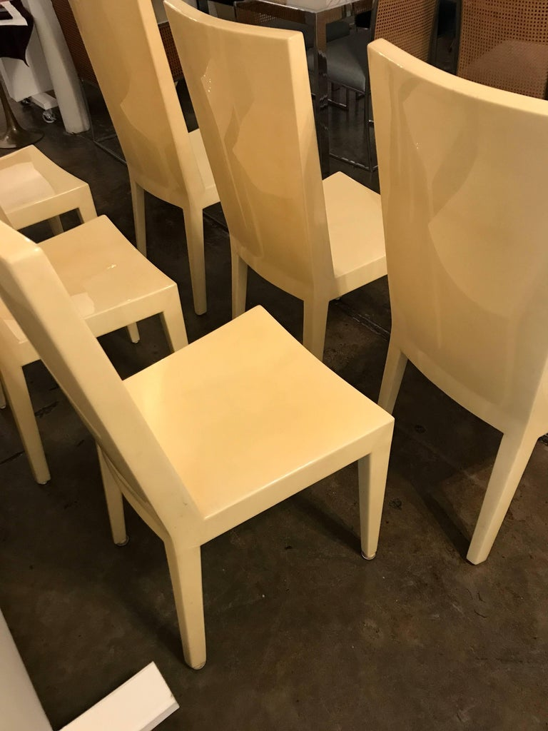 Offered is a Mid-Century Modern set of six lacquered goatskin parchment KMF side / dining chairs in the style of Karl Springer. Exudes sophistication; linear in design with concave seats and backs. Quite comfortable and so very chic.