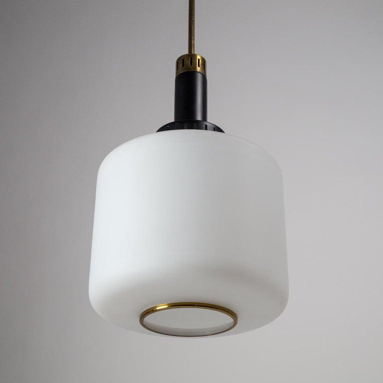 Mid-20th Century Pair of 1950s Stilux Pendants, Satin Glass, Brass, Lacquered Aluminium For Sale